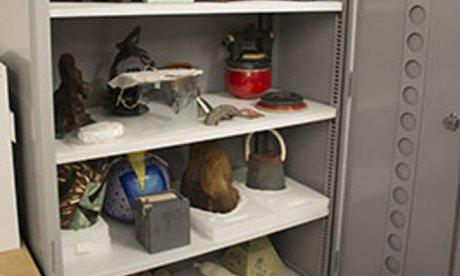 open storage cabinet filled with artifacts