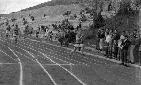 black and white photo of a track meet