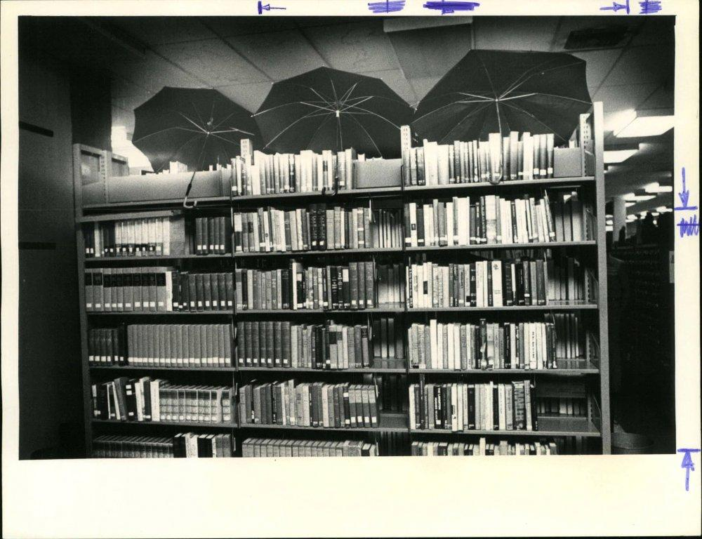 Clearwater Main Library bookstacks under a roof leak in 1978
