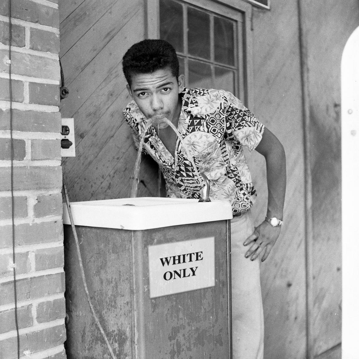 "Water fountain with ""white only"" sign in 1956"