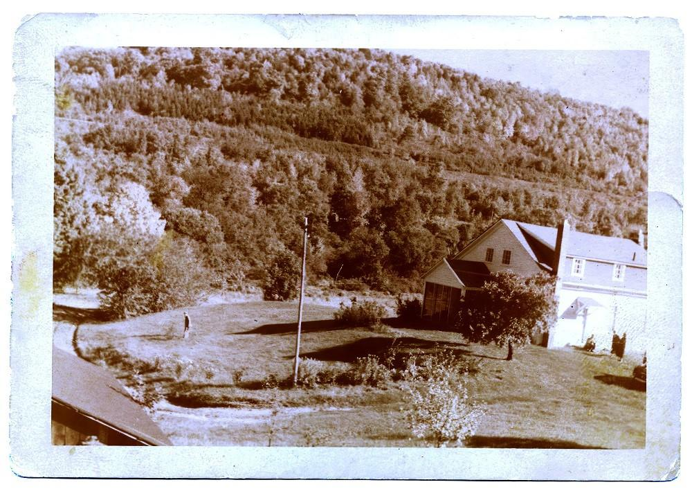 Historical photograph of Dennis Farmhouse looking east from hillside