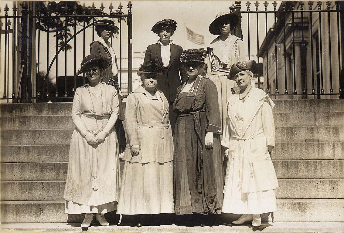 Suffragists standing outside Wilson White House, where they had made inroads