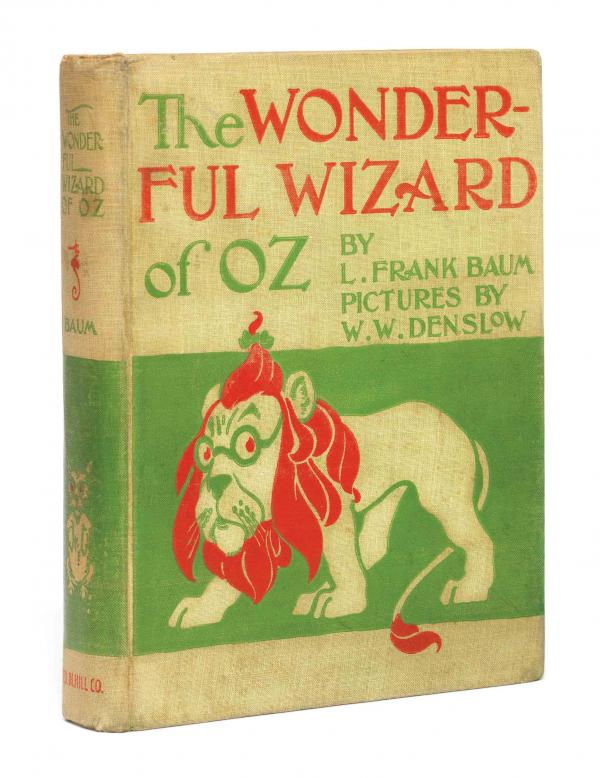 The 1900 First Education of L. Frank Baum's classic children's novel The Wonderful Wizard of OZ. It is yellow with red and green text and lion is depicted in yellow, green, and red with a green background.