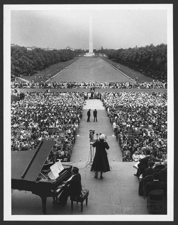 Marian Anderson sings to an audience at the Lincoln Memorial in 1952. The Washington Monument and reflecting pool is in the background.