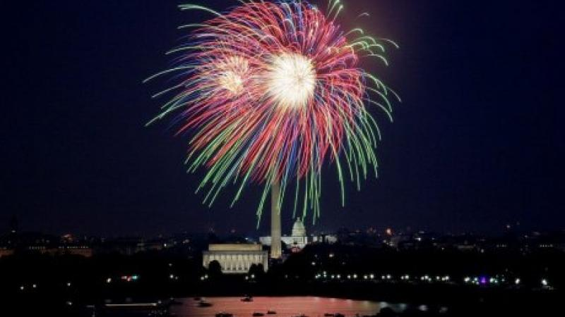 Photo of fireworks exploding over the White House at night