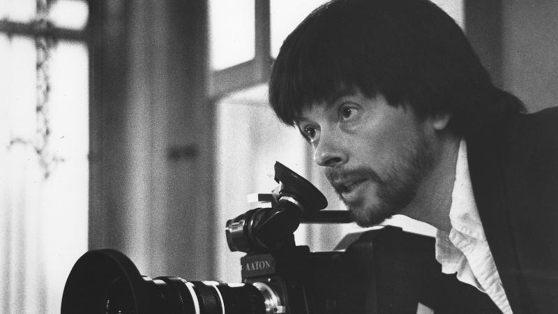 Black and white photo of Ken Burns wielding a camera.