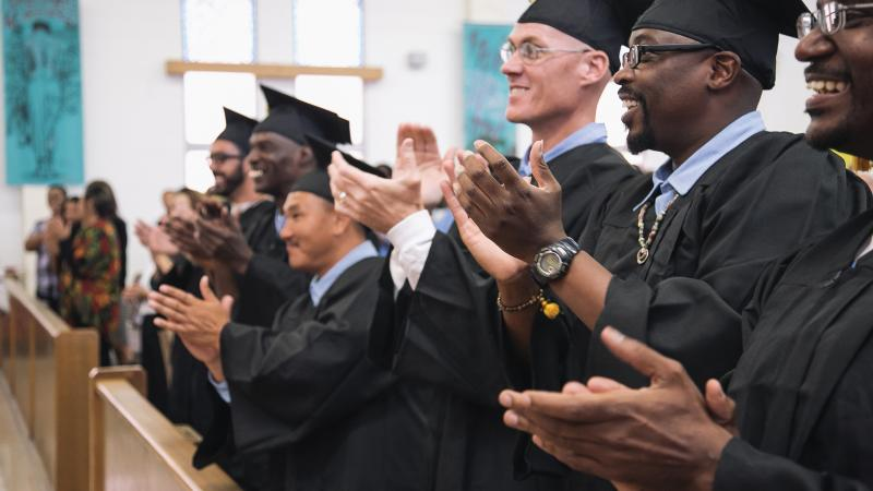 Graduates of the Prison University Project, clapping