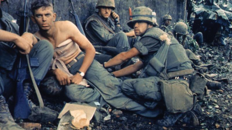 Marine D. R. Howe treats PFC. D. A. Crum's wounds during the battle for Hue