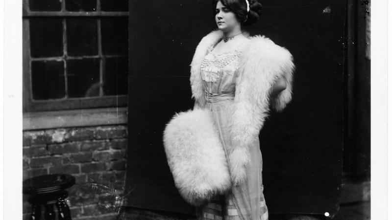 Portrait of a Storyville prostitute, wearing a fur stole