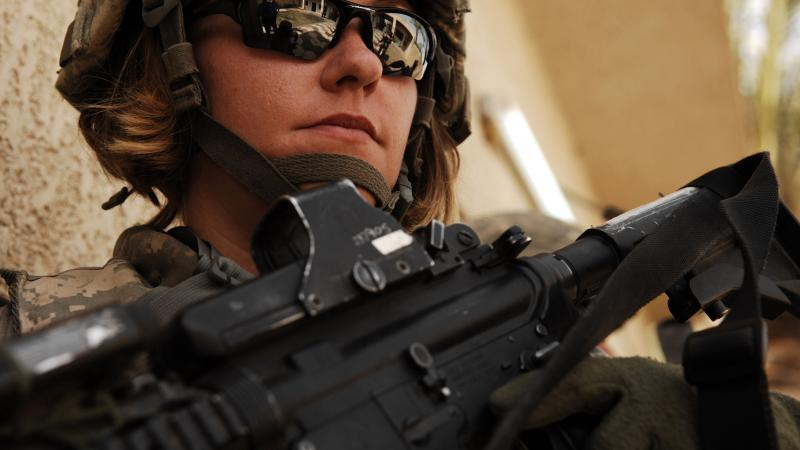 Headshot of a female American soldier in Iraq, in full field uniform