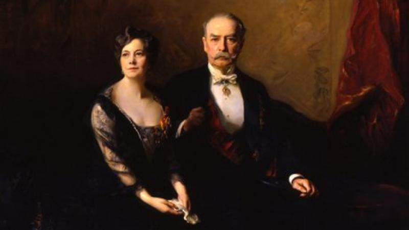 Stately painting of a man and woman dressed in formal attire.