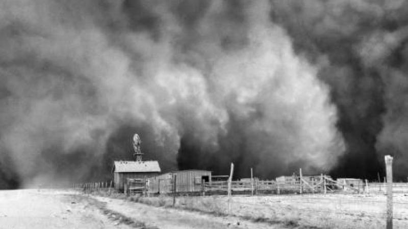 photograph: Black Sunday dust storm approaching Ulysses, Kansas, April 14, 1935