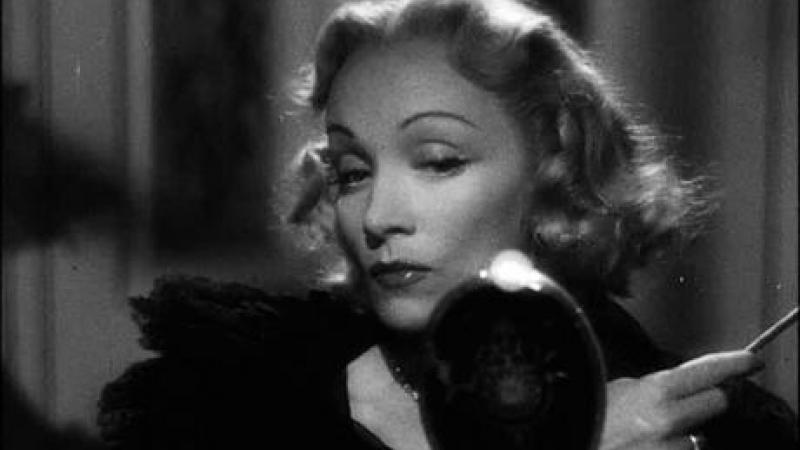 A black and white still of Marlene Dietrich in Stage Fright