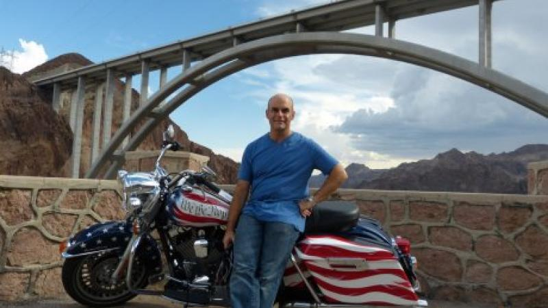 Peter Sagal with motorcycle: Constitution USA