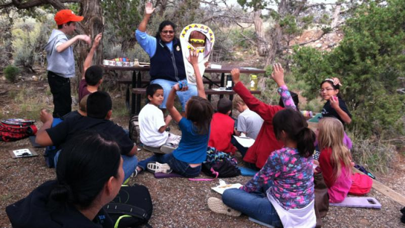 Photo of students learning about Ute cultural artifacts