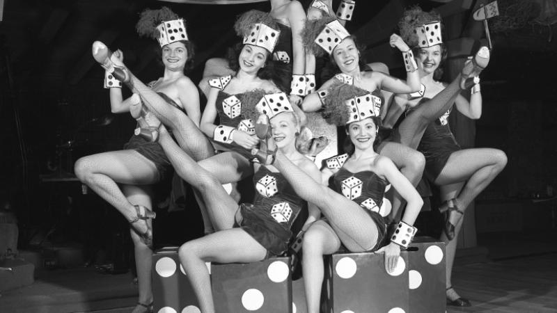 black and white photo of women onstage in costumes