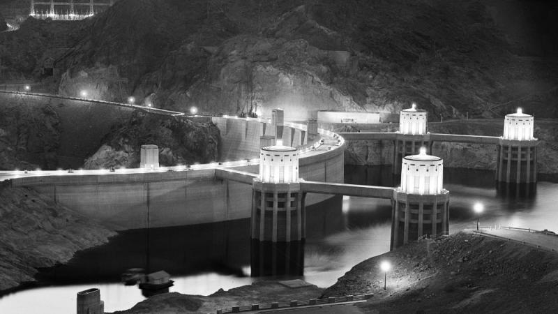 black and white photo of the Hoover Dam at night
