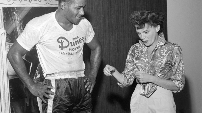black and white photo of Judy Garland and Floyd Patterson