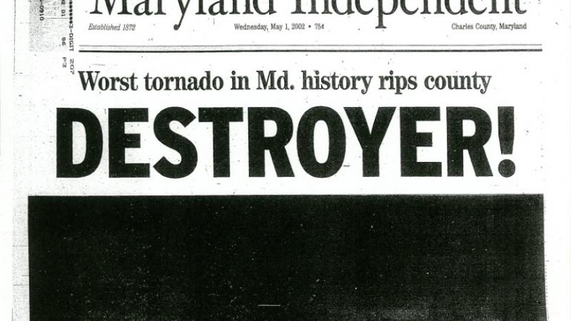 "Newspaper headline reading ""destroyer!"""