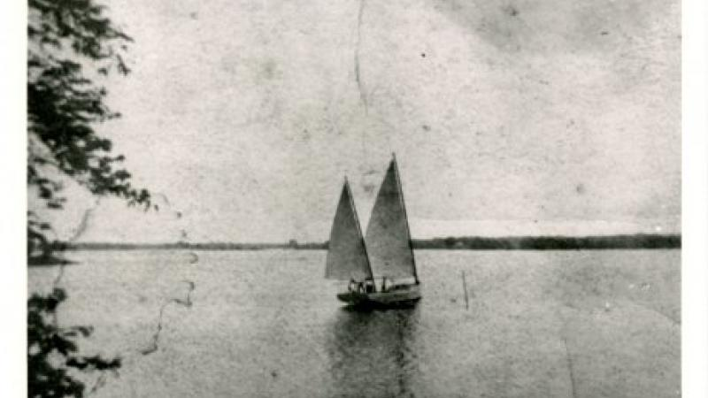 black and white photo of a sailboat