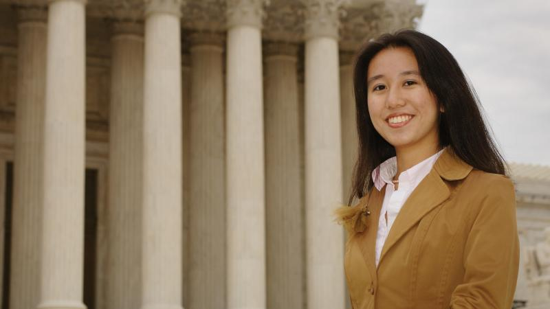 Image of young woman in front of Supreme Court building