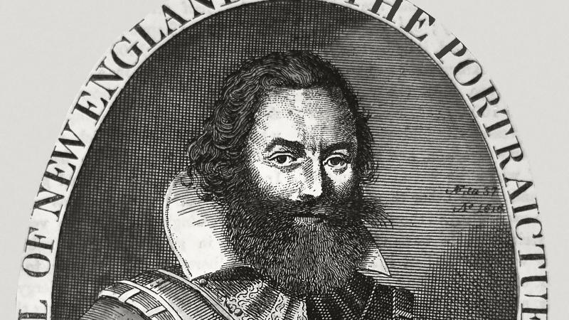 black and white engraving of man with beard in frilled collar