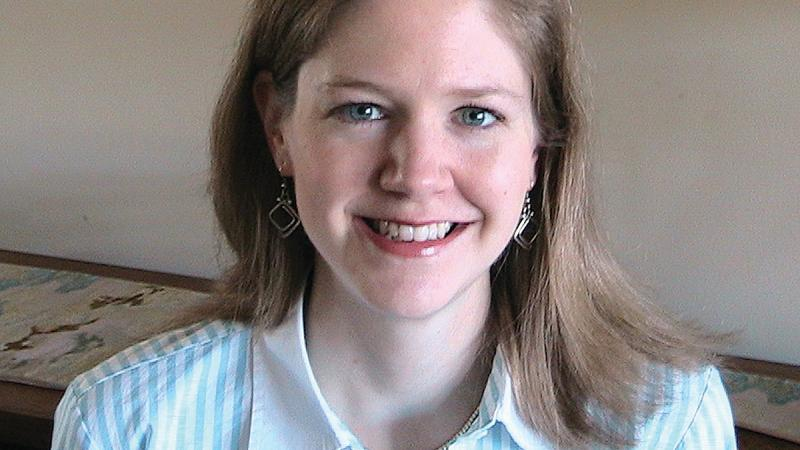 Photograph of woman in a blue shirt