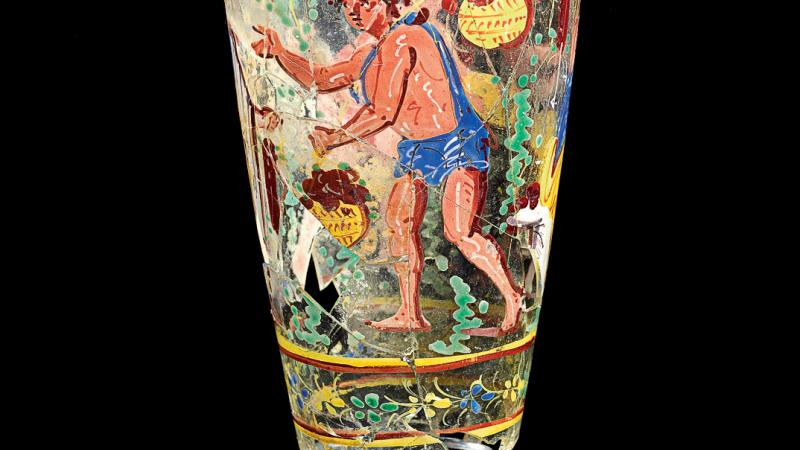 antique goblet with human figure painted on it