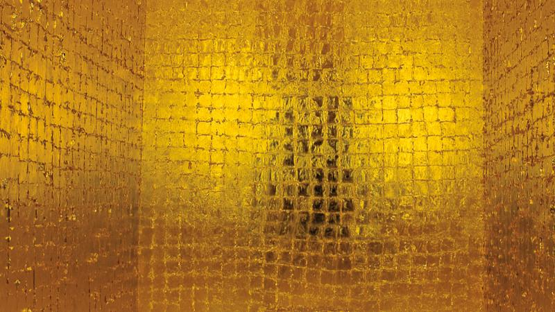 Shimmering gold square tiles panel a room