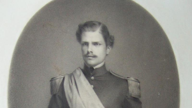 Black and white portrait of William Orton Williams in military dress.