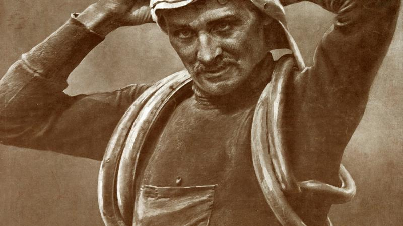 Sepia-colored photo of cyclist Francois Faber adjusting his riding goggles.