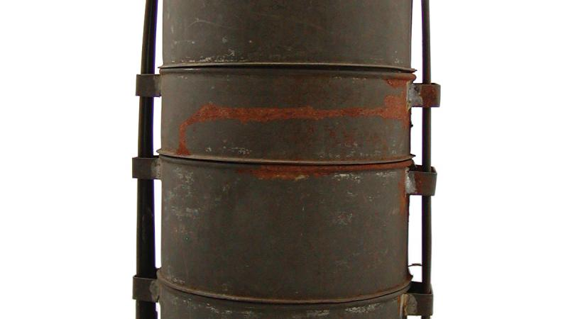 A cylindrical can with a long handle