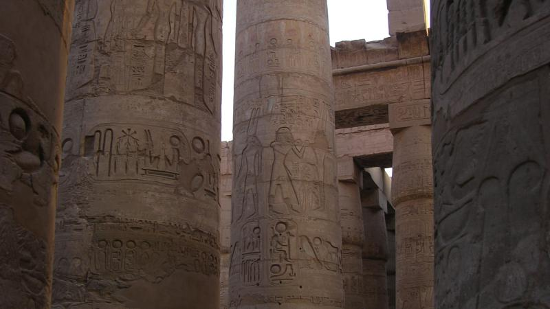 Tall columns carved with Egyptian illustrations of religion and royal life