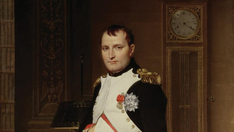 Napoleon, in full military dress, standing in his sumptuous study