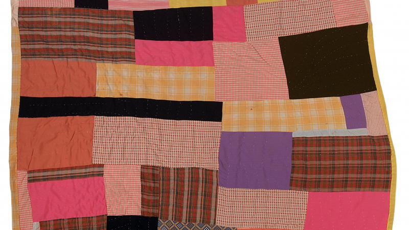 Photograph of a quilt made with various fabrics