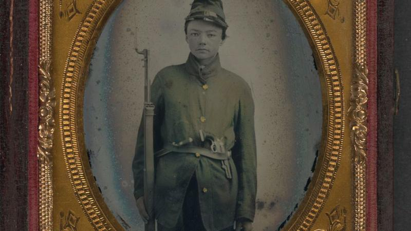 Framed black and white photo of a Union Soldier, duly outfitted.