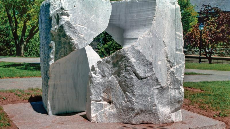 Photo of a large sculpture of marble shaped in an abstract form.