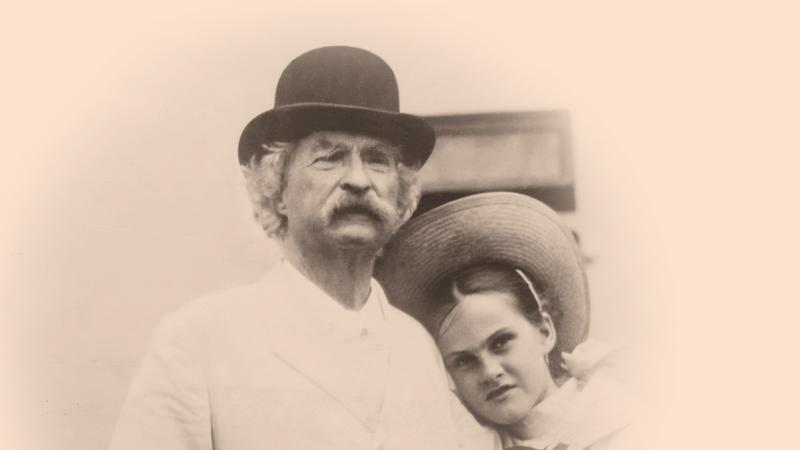 Twain, in a bowler hat, with Quick wearing a straw hat and leaning on his shoulder