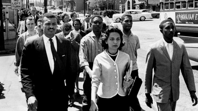 Nashville Freedom Riders walk down the street in a group, with Diane Nash at the front