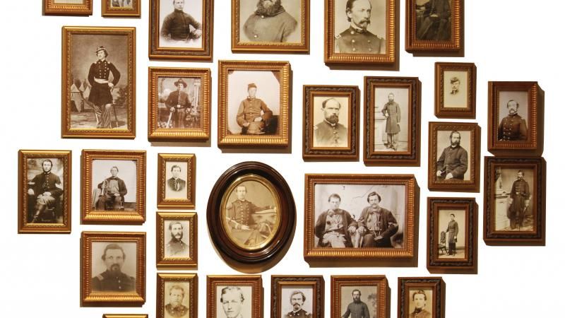 Collection of sepia photos of civil war soldiers, in wood frames