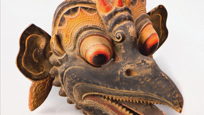 Bird mask with long beak and teeth, painted in brown, gold and orange