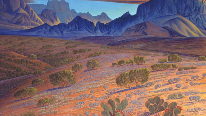 Desert landscape in warm tones, with the distant blue mountain range made into the profile of a man