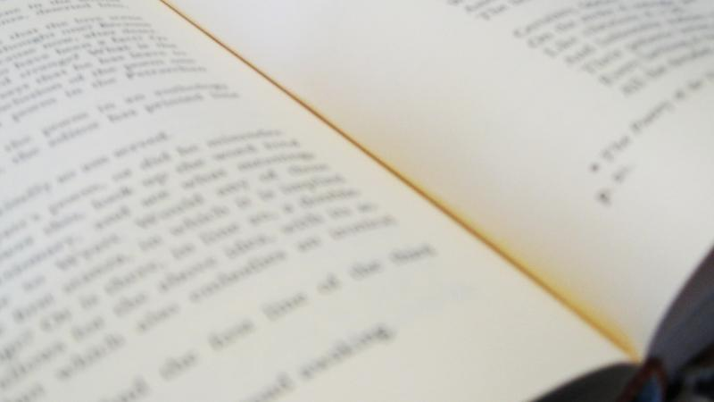 Close view of an open book of poetry