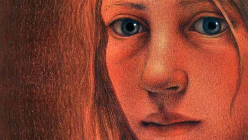 A reddish-hued portrait of a young girl, close up.