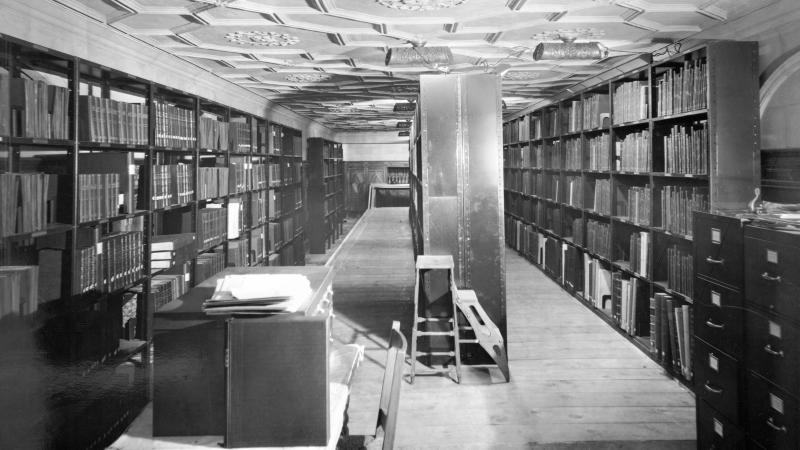 Black and white photo of an underground reference library.