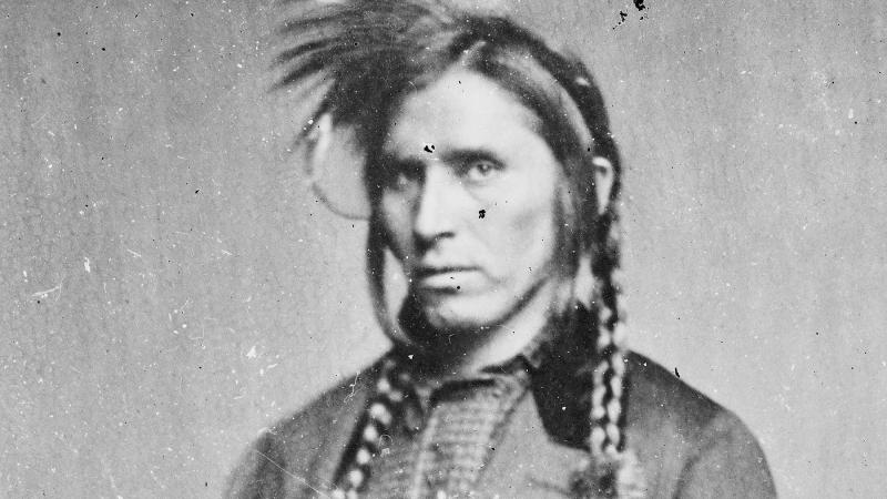 Black and white photo portrait of a Native-American man.