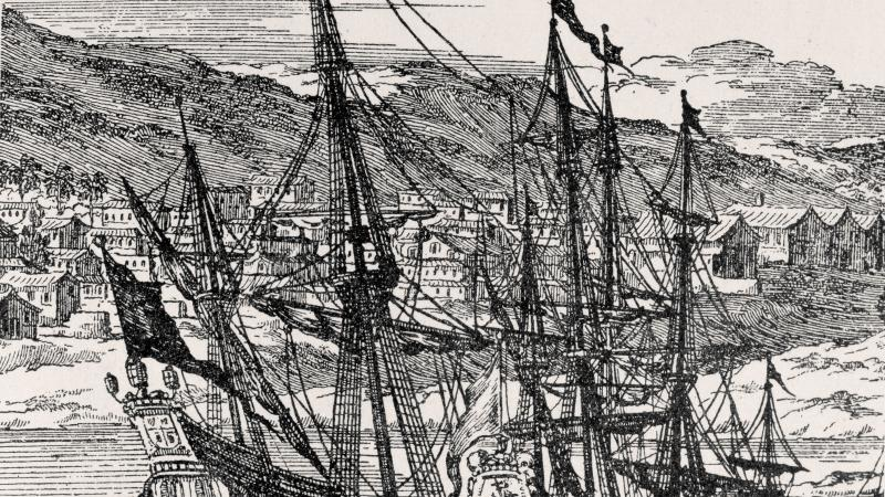Drawing of two Spanish frigates sailing in front of a small coastal settlement.