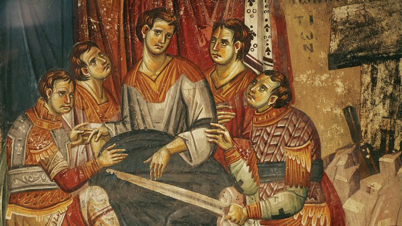 Fresco of five soldiers sitting and dividing the coat of Christ.