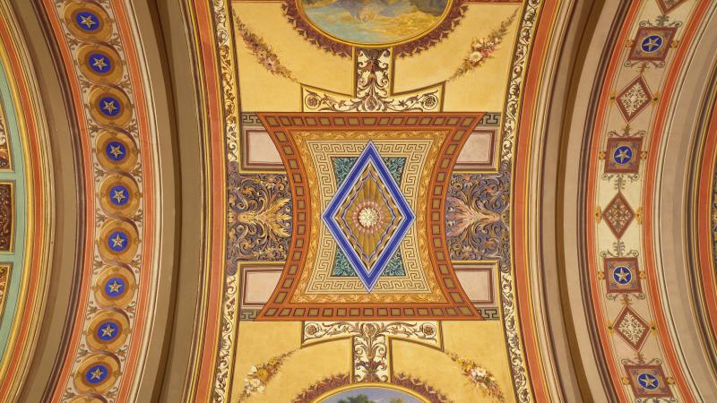 Photo of a colorful and ornate mosaic adorning a vaulted ceiling in the Senate building.