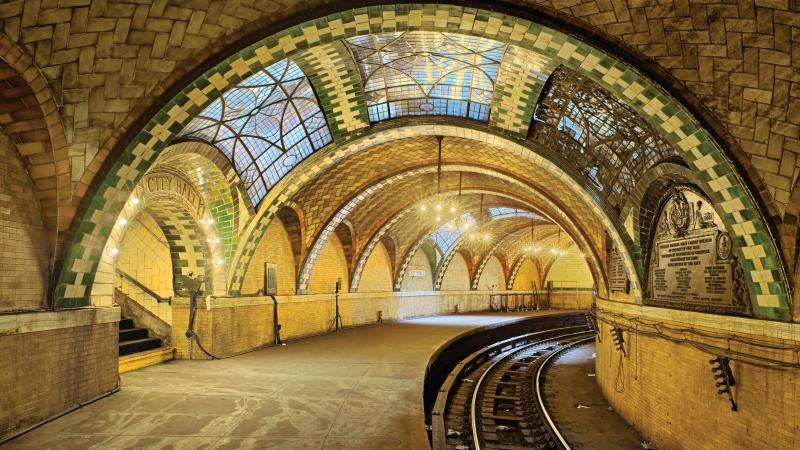 Photo of the New York city hall subway station, which boasts an ornate vault with stained glass windows.